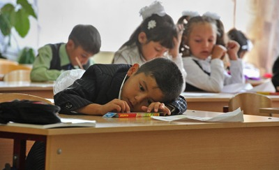Путин потребовал обучить детей мигрантов русскому языку