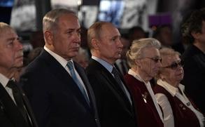 Путин призвал пресекать попытки отрицания Холокоста